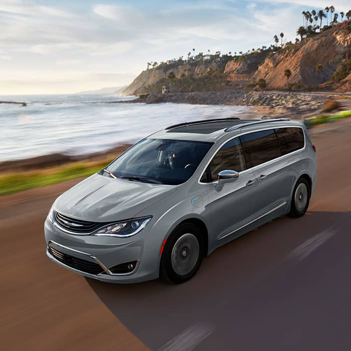 Chrysler Pacifica Hybrid Being Driven Near A Waterfront