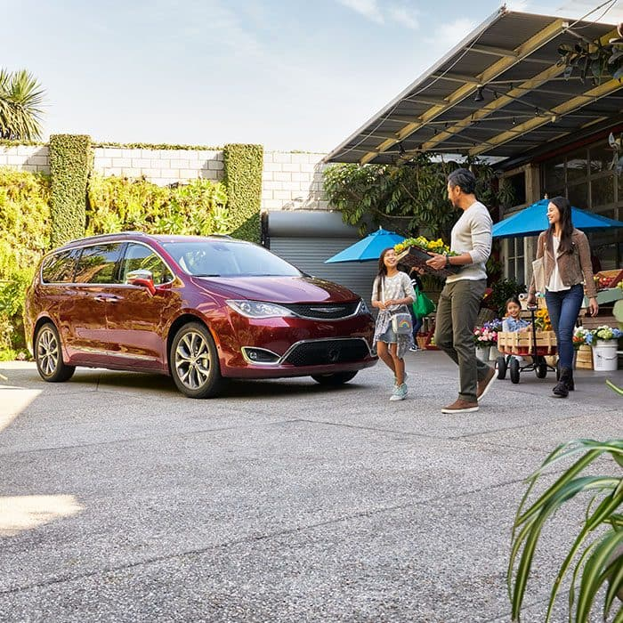 Family Walking Towards A Parked Chrysler Pacifica At Garden Center