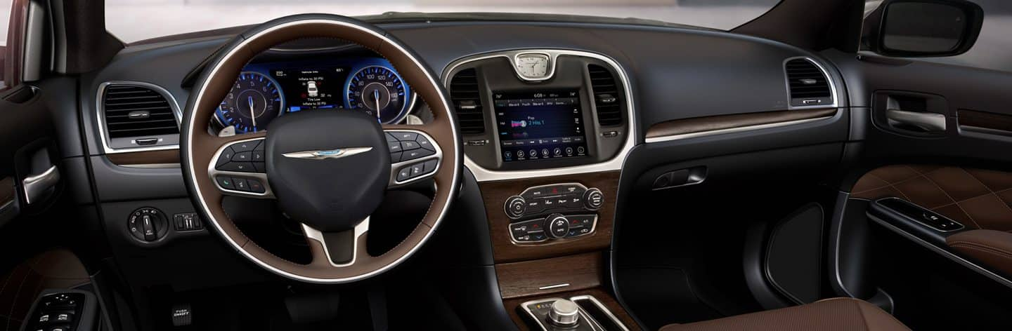 The steering wheel, instrument panel, Uconnect touchscreen and center stack controls on the 2020 Chrysler 300C.