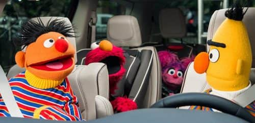 Sesame Street muppets inside of a Chrysler Pacifica.